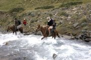 We cross the river on horseback
